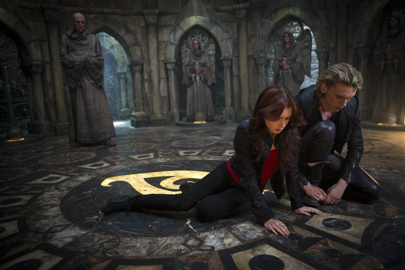 """Lily Collins and Jamie Campbell Bower in the new action-adventure film """"The Mortal Instruments: City of Bones."""""""