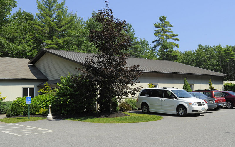 A van at the LogistiCare office in Kennebunk is among eight the contractor says it bought to provide rides because it lost so many volunteer drivers over reimbursement rates.