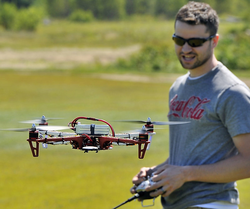 Adam Courtemanche of Portland tests his F450 Quadcopter before attaching a GoPro camera to search for a member's missing plane.