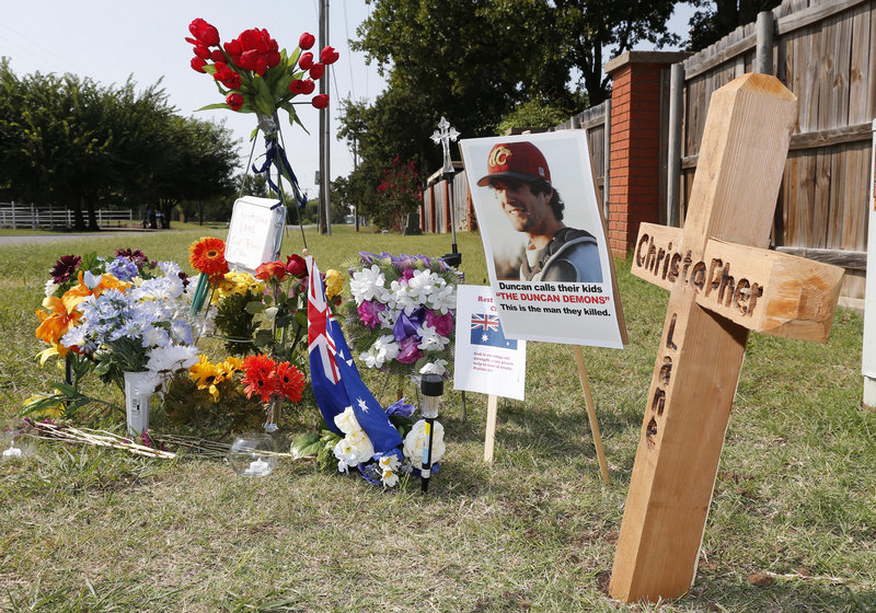 A memorial to Christopher Lane is shown along the road where he was shot and killed in Duncan, Okla. Lane, an Australian who was on a baseball scholarship at East Central University in Ada, Okla., was in Duncan visiting his girlfriend when he was gunned down.