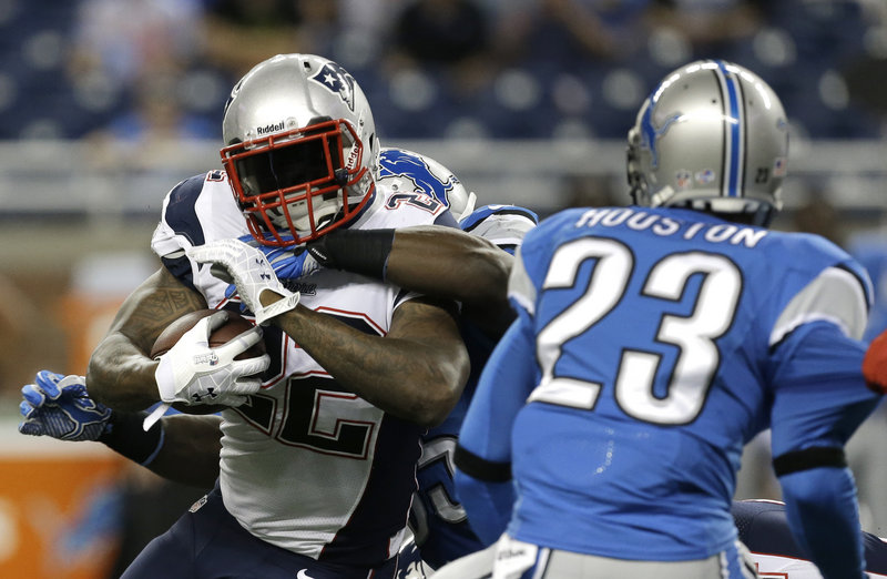 New England running back Stevan Ridley finds no room for comfort against a tenacious Detroit defense in the first quarter.