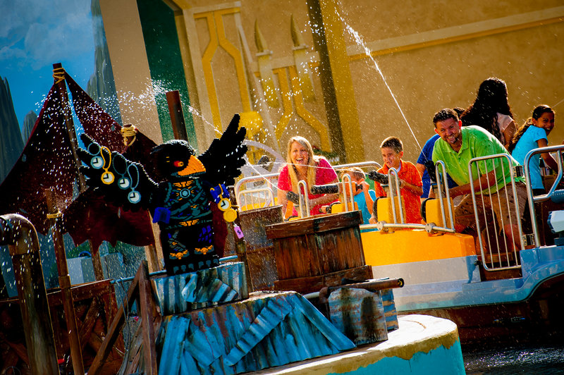 Families try the Quest for Chi, a new water ride in the World of Chima at Legoland Florida near Orlando. The queue line is used to bring guests up to speed on the Chima story.