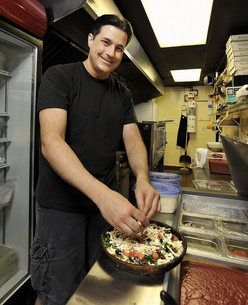 Ed Horvath puts together a specialty pie at You Wanna Pizza Me.