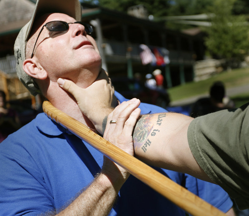 Volunteer Shawn Withers, left, advises Marines veteran David Marino, a Medford native who lives in Burbank, Calif., on a self-defense technique using a cane Saturday at Camp Wavus on Damariscotta Lake in Jefferson.