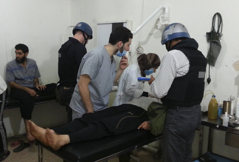 "U.N. chemical weapons experts visit victims of an apparent gas attack at a hospital near Damascus on Monday. ""This is the effect of chemicals,"" said a man who appeared to be a doctor."
