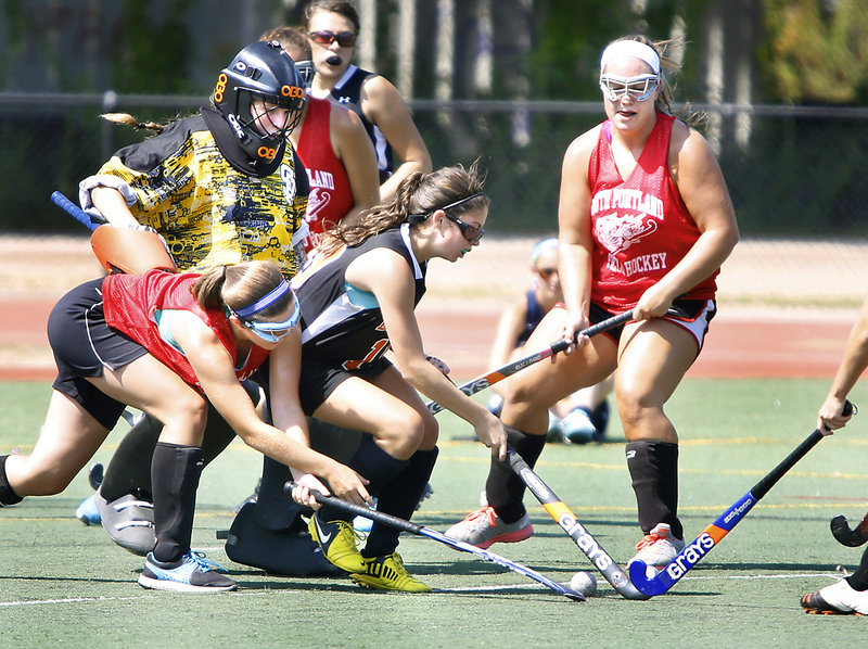South Portland goalie Hannah Gato is surrounded by a mix of players as teammate Lydia Henderson, left, tries to poke the ball from Biddeford's Mallory Mourmouras while Olivia Indorf, right, of South Portland looks on at Fitzpatrick Stadium on Tuesday.