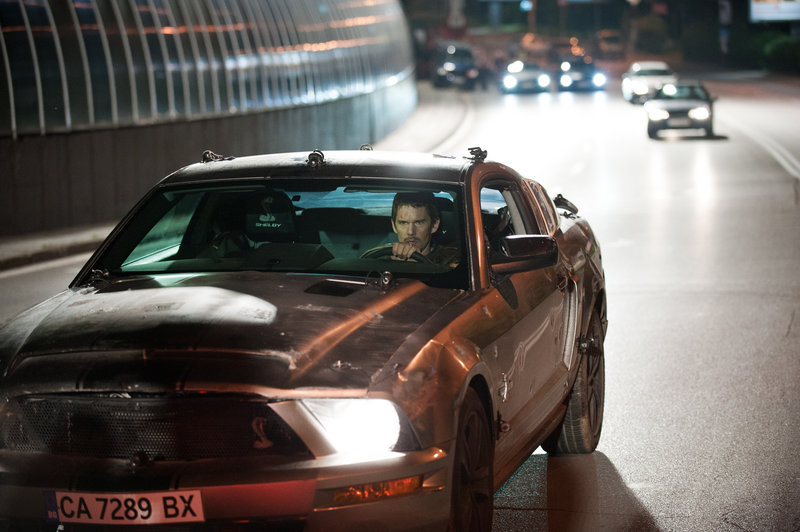 """Ethan Hawke stars as a disgraced racecar driver trying to save his wife (Rebecca Budig) from kidnappers in """"Getaway."""""""