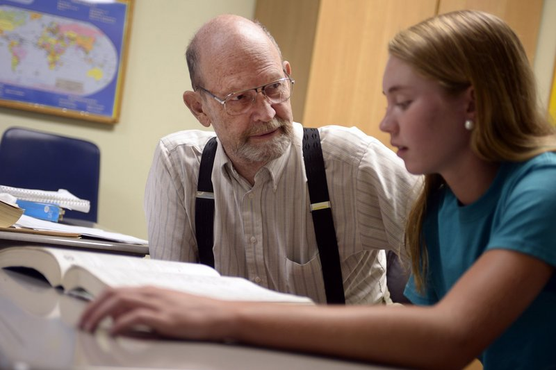 Lewis Kasparek, a top SAT prep tutor, works with high school junior Emily Herron on Aug, 13 in Charlotte, N.C. He says sometimes even brilliant students are stumped by the SAT.