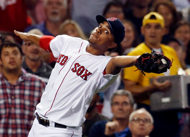Xander Bogaerts, third baseman for the Red Sox, catches a foul pop by Baltimore's Nate McLouth in the third inning Wednesday night at Fenway Park. The Red Sox rallied for a 4-3 victory.