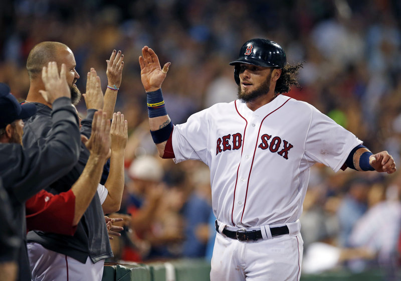 Jarrod Saltalamacchia receives high-fives after scoring the winning run against the Orioles on Mike Carp's pinch-hit single in the eighth inning Wednesday night at Fenway Park.