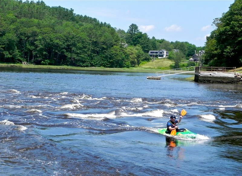 The Sheepscot Reversing Falls, a half-mile south of the Sheepscot River Bridge, are well-known among paddlers for the challenging waters created at mid-tide.