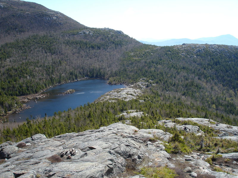 The Tumbledown Ridge Trail offers a fine view of Tumbledown Pond, a unique Alpine pond where hikers can enjoy a swim, cast for fish or just relax shoreside.