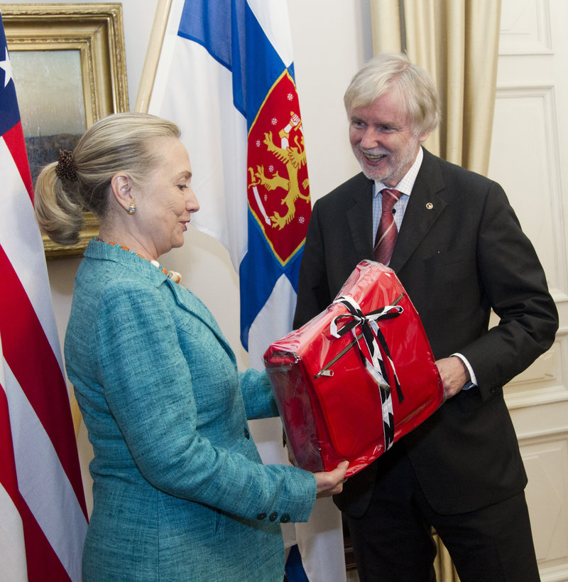 Secretary of State Hillary Rodham Clinton receives a gift from Finnish Foreign Minister Erkki Tuomioja at the Government Banquet Hall in Helsinki in 2012.