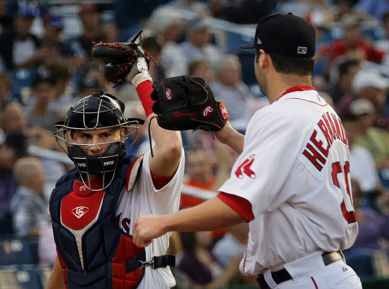 Portland catcher Christian Vazquez offers a glove bump to Sea Dogs starter Chris Hernandez after he pitched out of a fourth-inning jam in an 8-1 win over Trention at Hadlock Field on Friday. Vazquez had a good night at the plate, with a pair of doubles and two RBI.