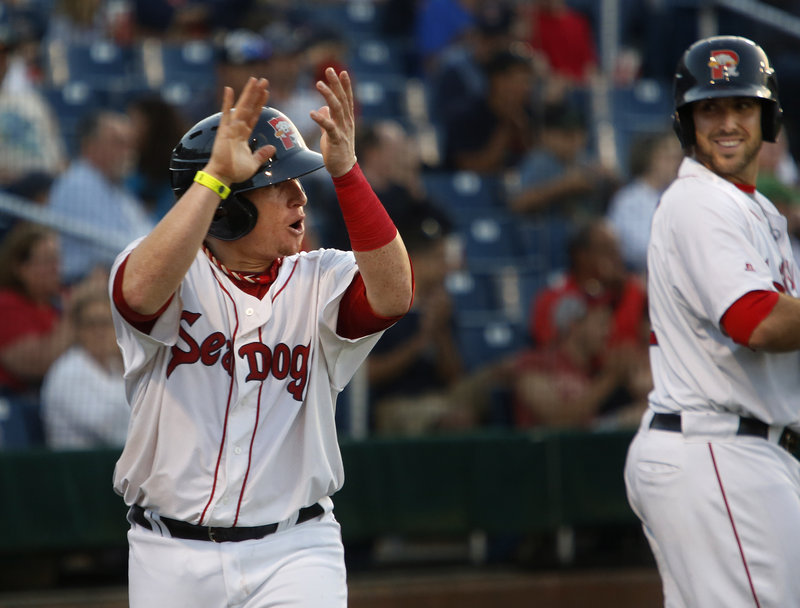 Portland's Christian Vazquez is justifiably pumped after being driven home by Michael Almanzar in the fourth inning.