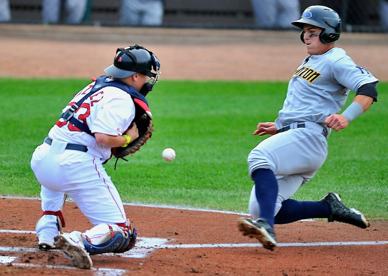 Portland catcher Christian Vazquez can't handle the throw as Trenton's Tyler Austin slides home during an 8-0 win by the Thunder at Hadlock Field on Saturday.