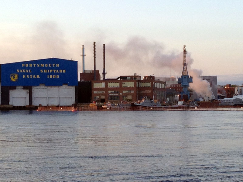 A fire burns on a nuclear submarine at the Portsmouth Naval Shipyard in Kittery, Maine in this Wednesday, May 23, 2012 file photo.