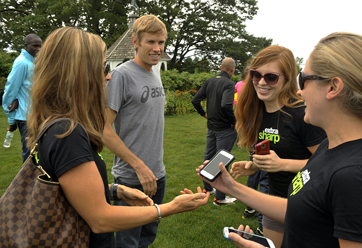 A group of young women, including Anne Mauney, right, ask to have their photos taken with American runner Ryan Hall following the Beach to Beacon 10K news conference at Inn by the Sea in Cape Elizabeth on Friday.