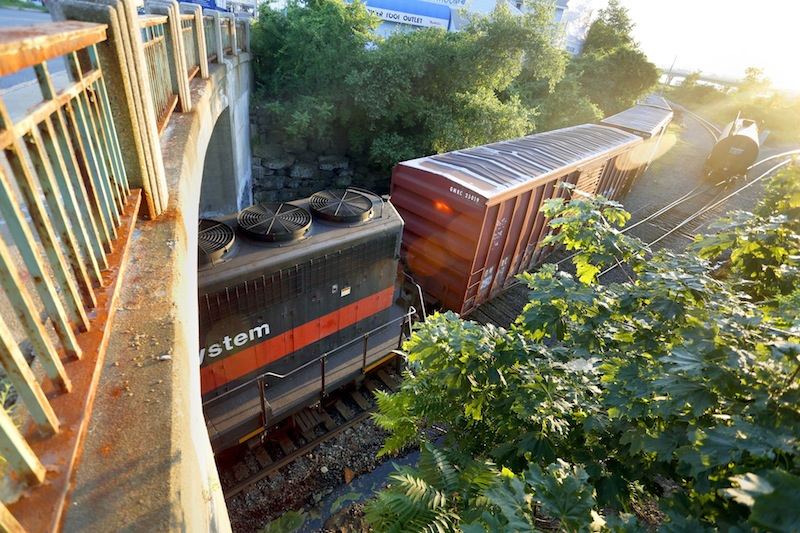 In this July 2013 file photo, a Pan Am Railways train passes under the Danforth Street Bridge at Cassidy Point in Portland. The U.S. Department of Labor has ordered Pan Am Railways to pay $50,000 in compensatory and punitive damages to an injured Waterville worker.