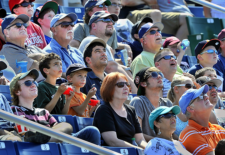 In this Wednesday, Aug. 21, 2013, fans keep an eye on a pop fly as the Portland Sea Dogs hosted the New Hampshire Fisher Cats at Hadlock Field. Despite good August numbers, the Sea Dogs experienced their lowest attendance numbers in 20 years this season.