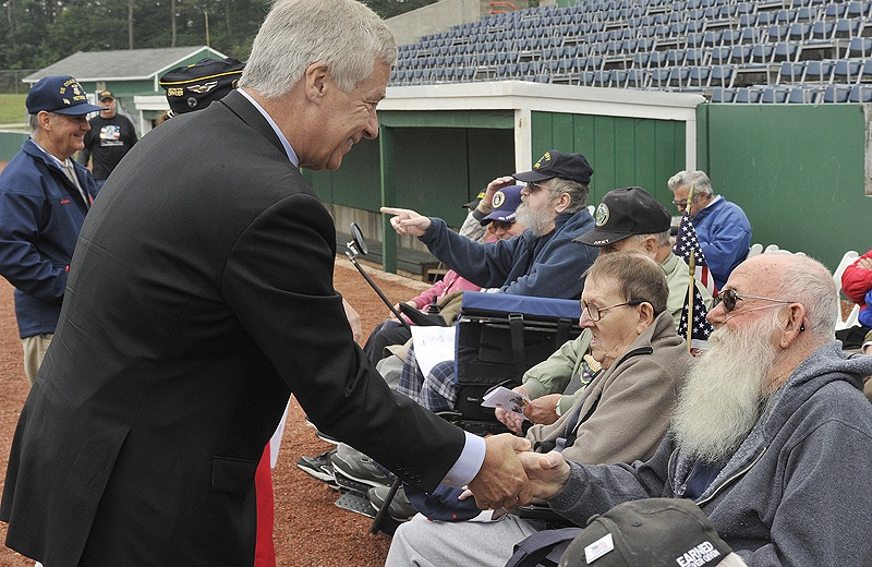 U.S. Rep. Mike Michaud greets veterans brought to the event from the Veterans Home.