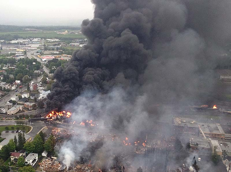 This aerial photo shows a fire in the town of Lac-Megantic as seen from a Sûreté du Québec helicopter Saturday, July 6, 2013 following a train derailment that sparked several explosions in Lac Megantic, Quebec. Nearly 50 people died in the disaster. (AP Photo/Sûreté du Québec via The Canadian Press)