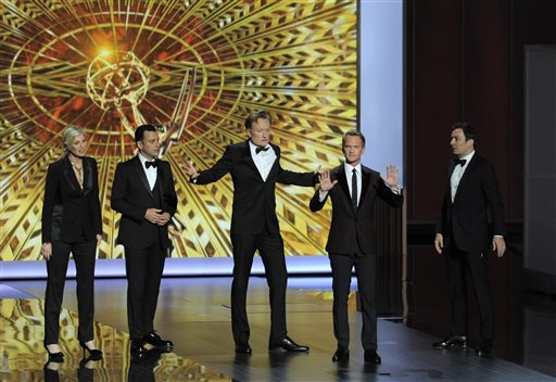 Jane Lynch, from left, Jimmy Kimmel, Conan O' Brien, Neil Patrick Harris, and Jimmy Fallon speak on stage Sunday at the 65th Primetime Emmy Awards at Nokia Theatre in Los Angeles.