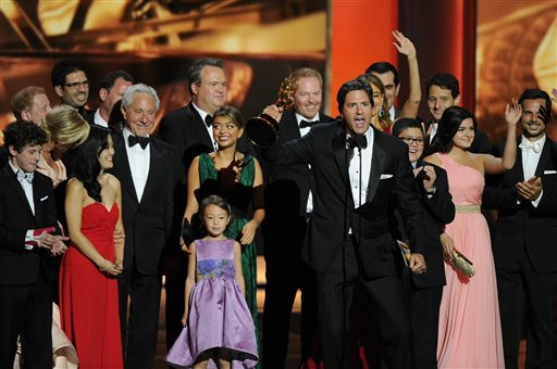 Steven Levitan, foreground, and the cast and crew of