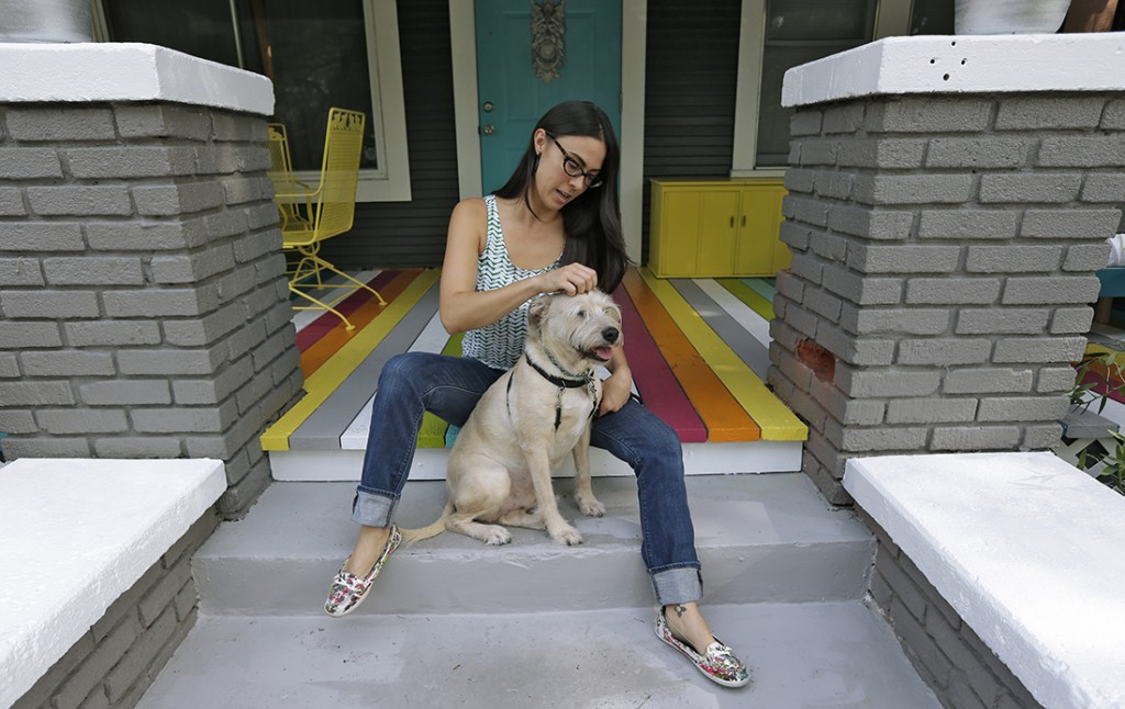 In this Wednesday, Sept. 4, 2013 photo, 32-year-old Jessi Spencer-Hammac poses with her dog Rocco, in Tampa, Fla. Decades before being diagnosed with bipolar disorder, Spencer-Hammac thought she was just moody, a restless dreamer with grand plans who had trouble finishing projects. (AP Photo/Chris O'Meara)