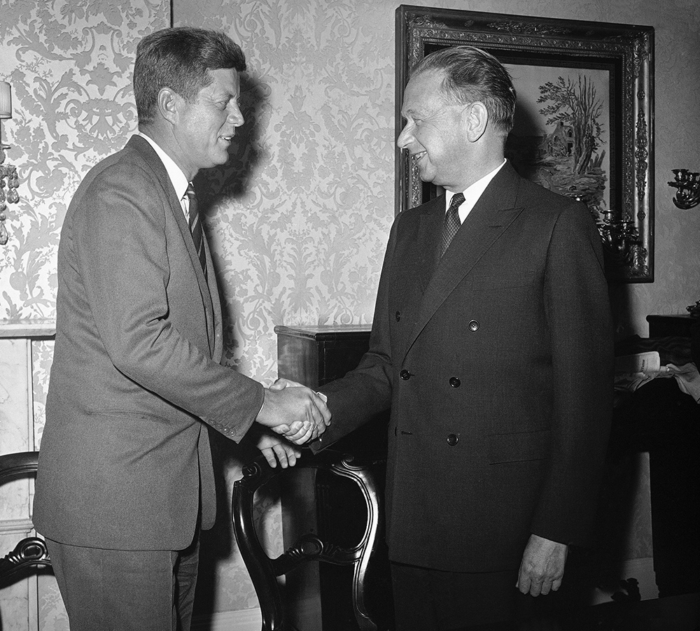 President-elect John F. Kennedy and United Nations secretary-general Dag Hammarskjold are shown at their conference in Kennedy's suite at the hotel Carlyle in New York City, Dec. 7, 1960. (AP Photo) Smiling Standing Face to Face Authority Greeting