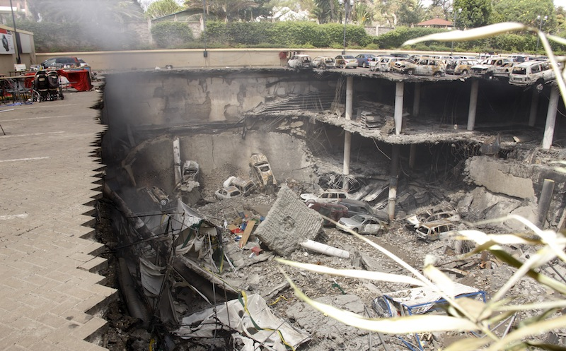 This photo released by the Kenya Presidency shows the collapsed upper car park of the Westgate Mall in Nairobi, Kenya Thursday, Sept. 26, 2013. Working near bodies crushed by rubble in a bullet-scarred, scorched mall, FBI agents continued fingerprint, DNA and ballistic analysis to help determine the identities and nationalities of victims and al-Shabab gunmen who attacked the shopping center, killing more than 60 people. (AP Photo/Kenya Presidency)