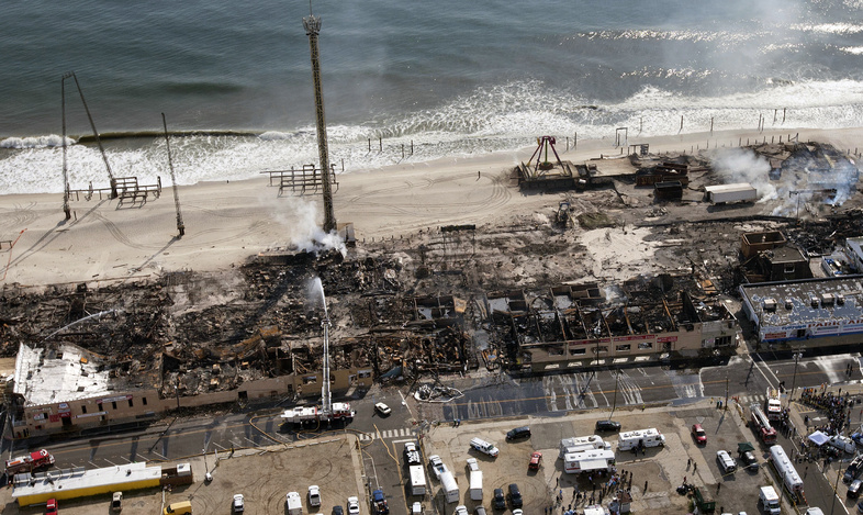 This aerial photo shows the aftermath of a massive fire that burned a large portion of the boardwalk Friday in Seaside Park, N.J.
