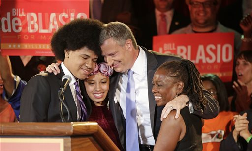 New York City Democratic Mayoral hopeful Bill De Blasio embraces his son Dante, left, daughter Chiara, second from left, and wife Chirlane, right, after addressing supporters at his election headquarters after polls closed in the city's primary election Wednesday, in New York.