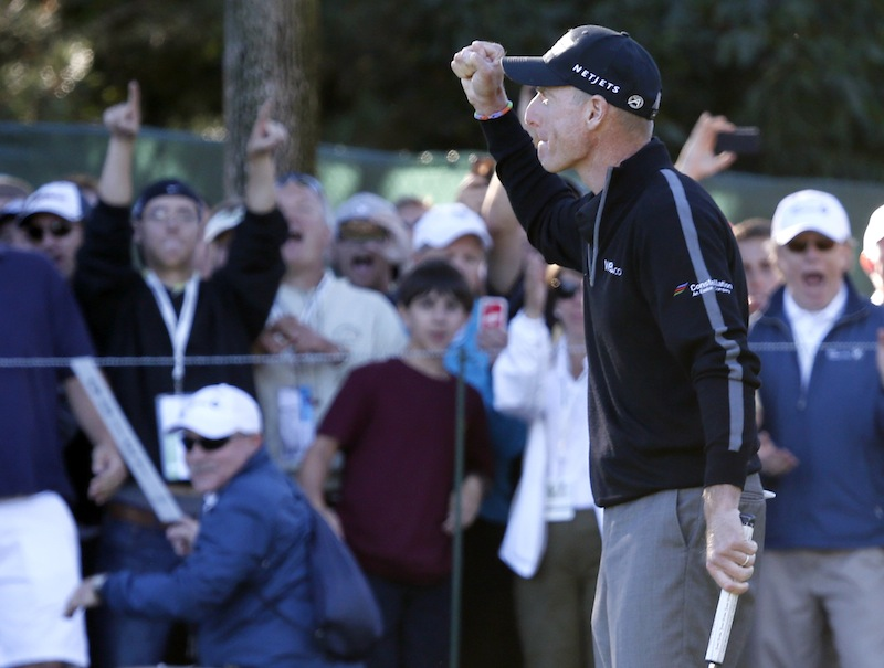 Jim Furyk pumps his fist after posting a 59, tying the PGA single round record, during the second round of the BMW Championship golf tournament at Conway Farms Golf Club in Lake Forest, Ill., on Friday.