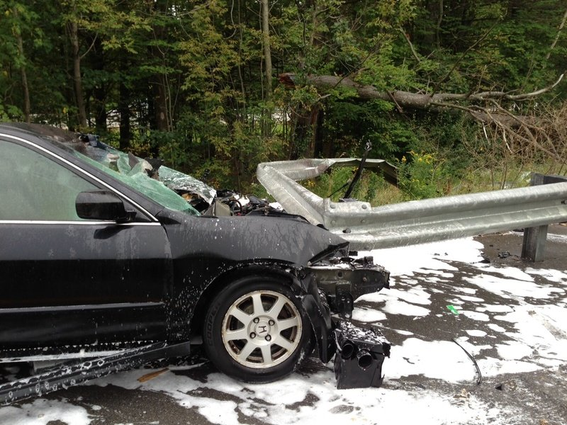 A Brunswick man escaped serious injury Tuesday afternoon when his car slammed into a guardrail along Interstate 295 in Bowdoinham and caught fire.