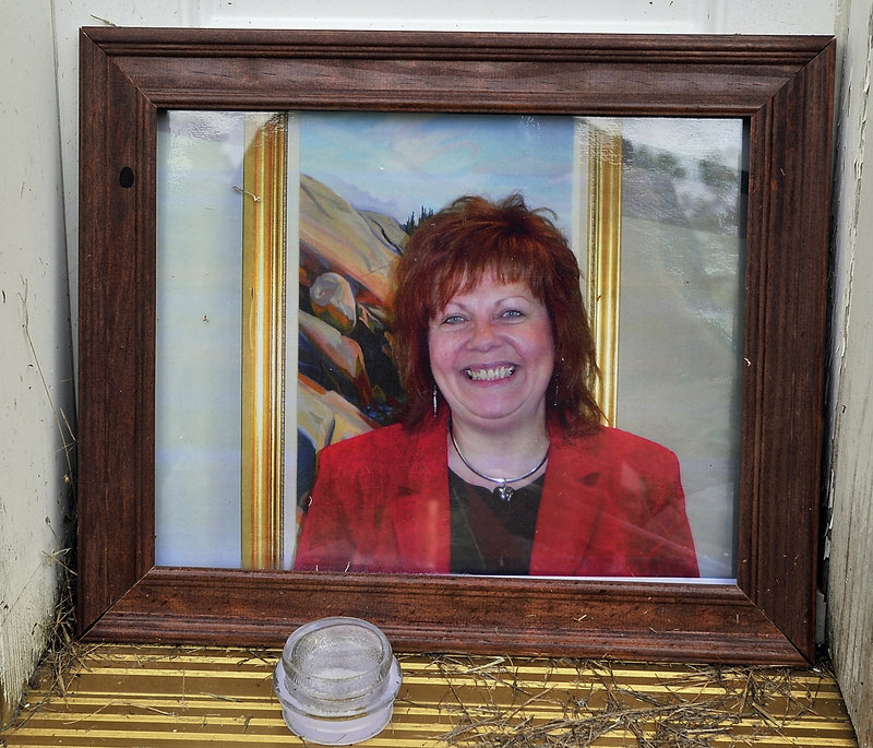 This portrait of Lynn Arsenault, 55, was among the items in a memorial laid at her doorstep Tuesday, Sept. 3, 2013. Police have charged Todd Gilday, 44, with her murder. Arsenault's son Mathew Day was also shot and injured in the incident at the Waldo Avenue house that Arsenault owned.