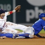 Boston's Stephen Drew and Toronto's Rajai Davis look for the call after Davis was caught stealing second base in the sixth inning Saturday at Fenway Park.