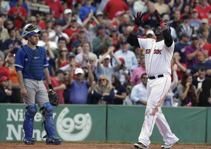 Boston Red Sox's David Ortiz, right, celebrates his home run off a pitch by Toronto Blue Jays' R.A. Dickey as Toronto Blue Jays' Josh Thole, left, looks on in the sixth inning of a baseball game at Fenway Park, in Boston, Sunday, Sept. 22, 2013. (AP Photo/Steven Senne)