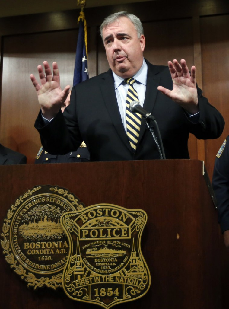 Boston Police Commissioner Edward Davis speaks during a news conference in Boston, Monday Sept. 23, 2013, announcing he is stepping down after seven years on the job. The 57-year-old Davis was appointed Boston's top cop by Mayor Thomas Menino in 2006. He previously served as the Lowell, Mass., police superintendent. (AP Photo/Elise Amendola)