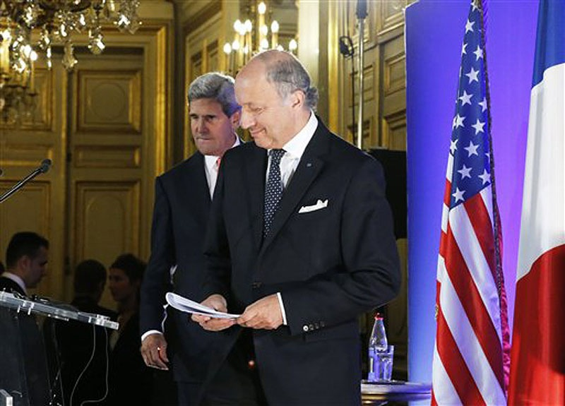 U.S. Secretary of State John Kerry, left, and France's Foreign Minister Laurent Fabius arrive for their meeting at the Quai d' Orsay in Paris on Saturday. Kerry traveled to Europe to court international support for a possible strike on the Syrian regime for its alleged use of chemical weapons while making calls back home to lobby Congress, where the action faces an uphill battle.