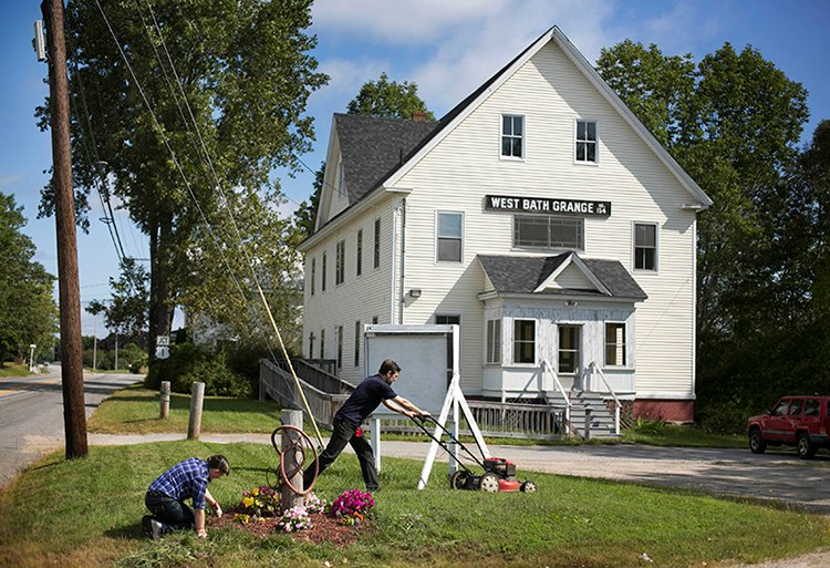 Angela and John Brigance spruce up the landscaping at the West Bath Seaside Grange. Granges are the nation's oldest farm and rural public interest organization.