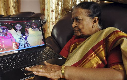 89-year-old Vege Koteshwaramma, looks at a photograph of her granddaughter Nina Davuluri, the first contestant of Indian origin to become Miss America, center on laptop screen, in Vijaywada, 174 miles east of Hyderabad, India, on Monday.