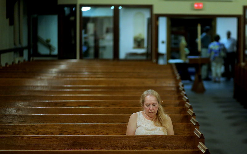 Determined to be the last person to leave the church, Sheila Duane of South Portland sits in her pew long after the final Mass at St. John the Evangelist Catholic Church in South Portland ended Wednesday night. Duane has been a parishioner at the church for 40 years, and struggled emotionally with its closing.