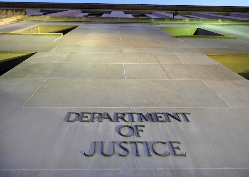 In this May 14, 2013, file photo, the Department of Justice headquarters building in Washington is photographed early in the morning. Former FBI explosives expert Donald Sachtleben of Carmel, Ind., said Monday, Sept. 23, he will plead guilty to revealing secret information for an Associated Press story about a U.S. intelligence operation in Yemen in 2012. The story led to a leaks investigation and the seizure of AP phone records in the government's search for the information's source. (AP Photo/J. David Ake, File)
