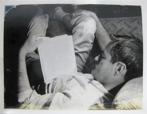 In this circa 1961 file photo provided by the New York Public Library, a curled-up Timothy Leary reads a book.