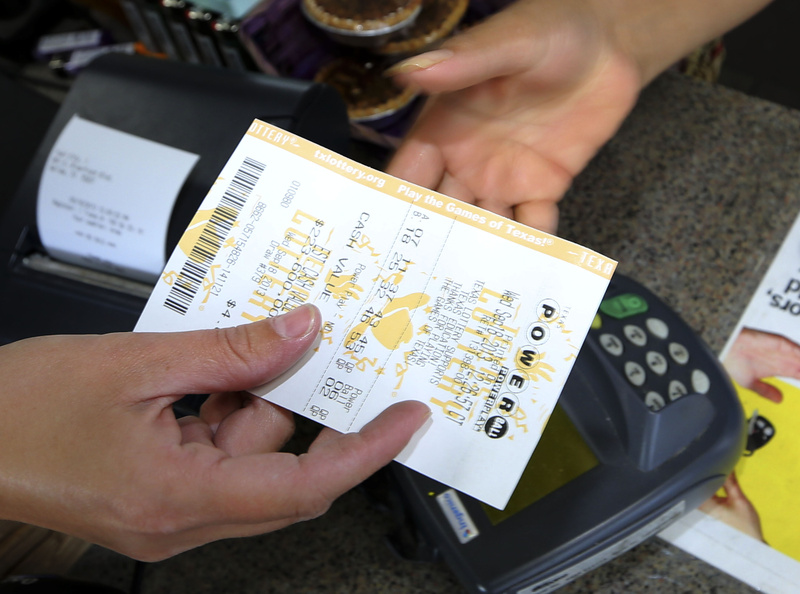 A Powerball lottery ticket is purchased at the Fuel City store in Dallas on Wednesday, when Powerball's estimated $400 million jackpot will be the nation's fifth-largest ever.