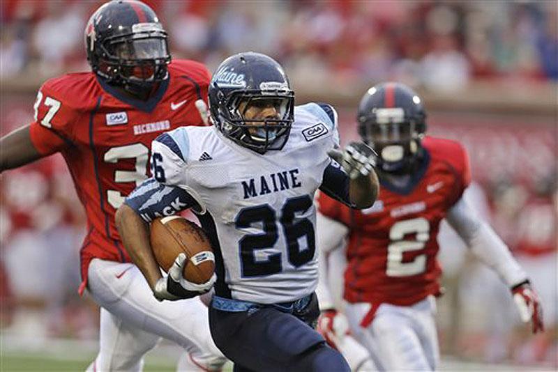 Maine running back Nigel Jones (26) runs for a touchdown in front of Richmond defensive backs Reggie Barnette (37) and Wayne Pettus (2) in the second half Saturday in Richmond, Va., Maine won 28-21.