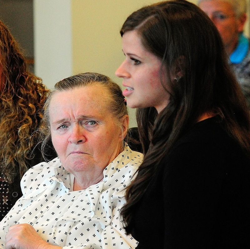 Jeannette Bancroft, 74, of New Gloucester, left, listens as Lauren Hurley, of Creative Work Systems, testifies about the problems Bancroft, who uses a wheelchair, has had getting rides to the Morrison Center in Scarborough, during a meeting of the Legislature's Health and Human Services committee on Wednesday, Sept. 11, 2013, in the Cross Building in Augusta.