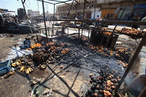 Remains of fruit smolder at the site of a car bomb attack at a vegetable market in Basra, 340 miles southeast of Baghdad on Sunday.
