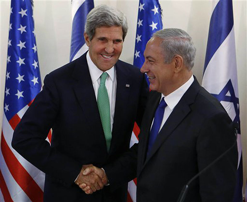 Secretary of State John Kerry shakes hands with Israel's Prime Minister Benjamin Netanyahu at the prime minister's office in Jerusalem on Sunday. Kerry sent a strong warning to Syria on Sunday, saying